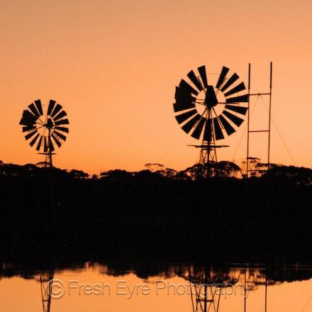 07BR03_014_Kerri Cliff - Windmills on Barna Dam at sunset
