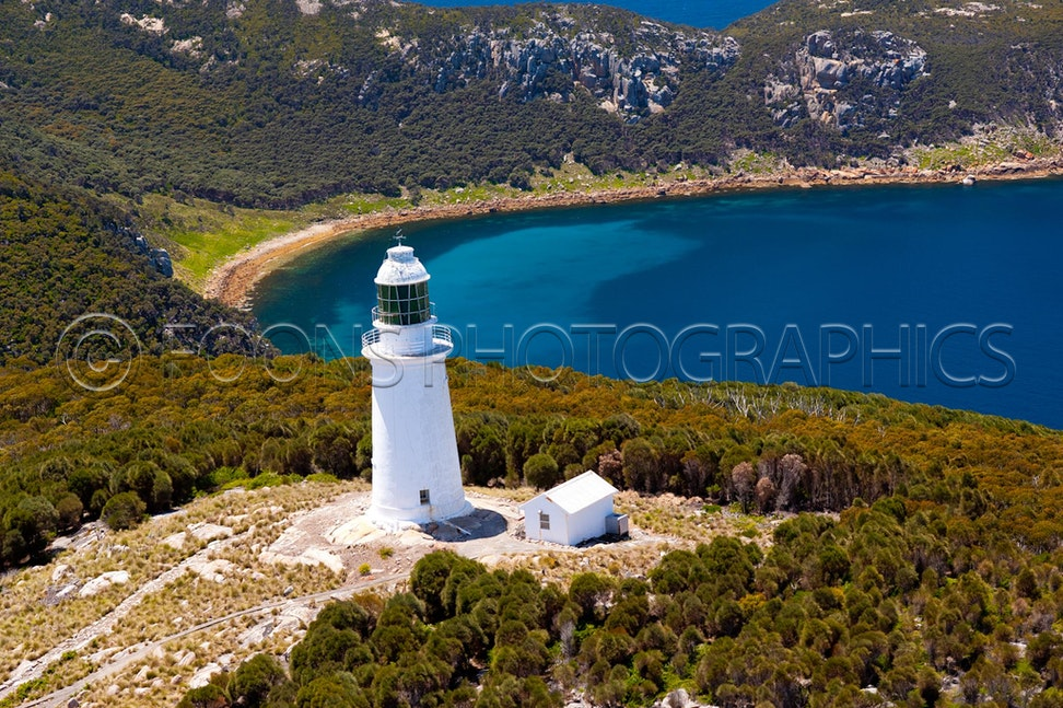11A 0518 - Aerial images of Deal Island in Bass Strait. This rugged outcrop offers a safe harbour to mariners travelling the route between Tasmania and...