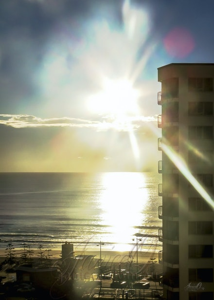 Sunrise Over the Gold Coast - The sun rises over the ocean on an early winter's morning.