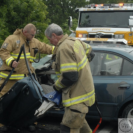 Entrapment - Martinsburg, WV, USA, June 17, 2015: Vol. firefighters from Bedington Vol Fire Department respond to a man trapped in car after an accident.